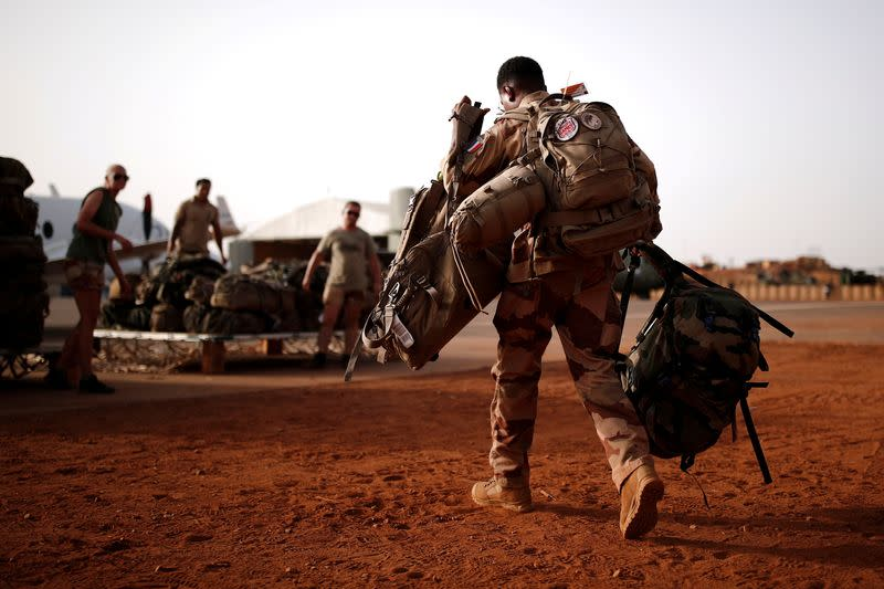 FILE PHOTO: A French soldier leaves with his backpack at the Operational Desert Platform Camp (PfOD) during the Operation Barkhane in Gao