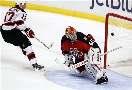 New Jersey Devils left wing Ilya Kovalchuk (17) scores against Florida Panthers goalie Jose Theodore (60) during a shootout in an NHL hockey game, Tuesday, Dec. 13, 2011, in Sunrise. The Devils won 3-2. (AP Photo/Wilfredo Lee)