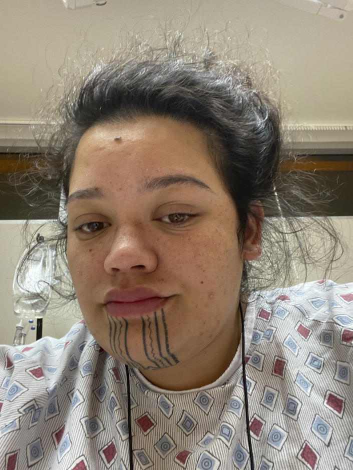 In this photo provided by Kuulei Perreira-Keawekane, she is seen in a selfie from her hospital bed on July 19, 2021, in Hilo, Hawaii. She tested positive for COVID-19, adding to the crisis that Hawaii is experiencing as hospitals are overflowing with a record number of patients, vaccinations are stagnating and Native Hawaiians suffering a disproportionate share of the suffering. (Kuulei Perreira-Keawekane via AP)