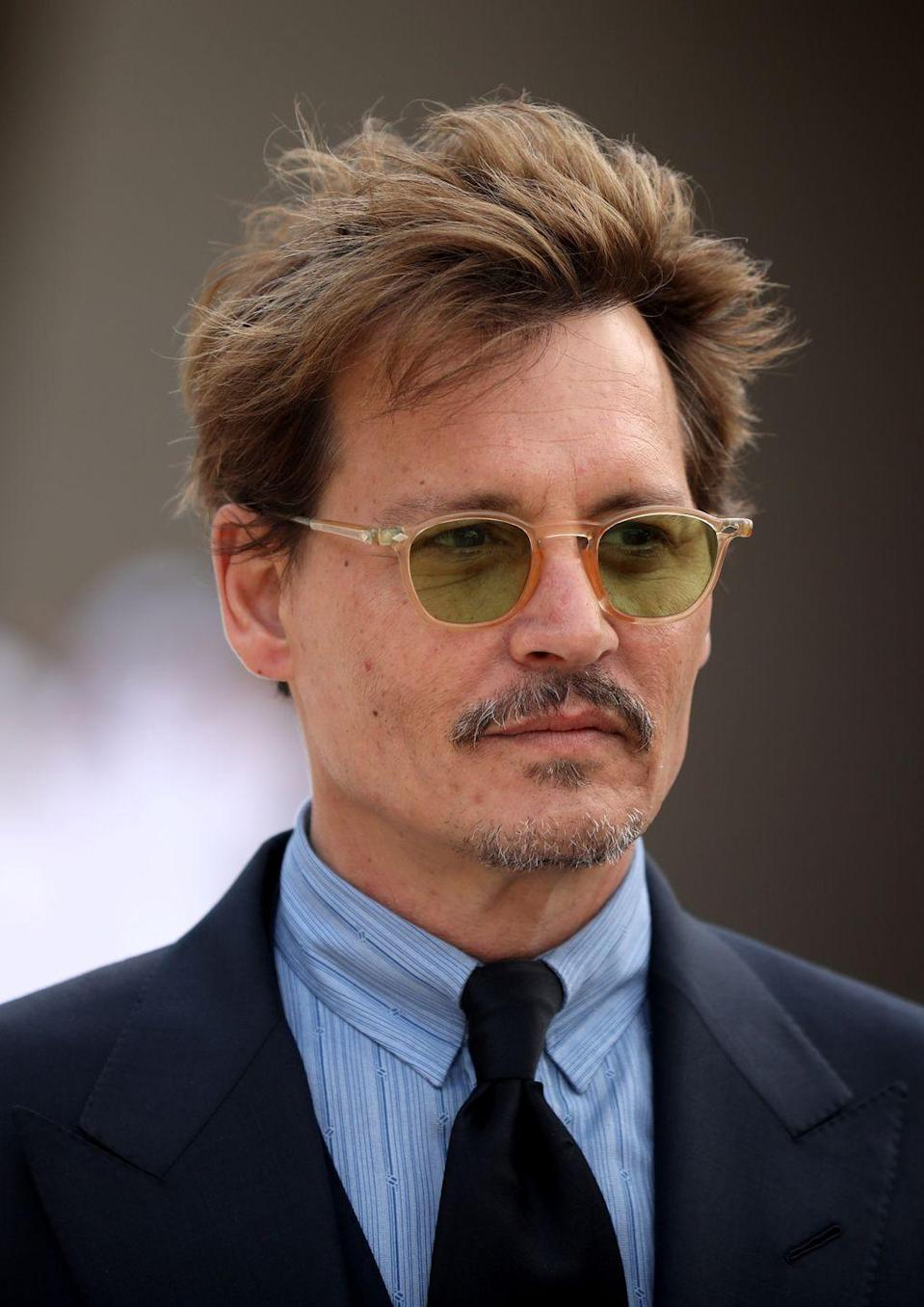 """<p>Johnny Depp's life has taken a darker turn in recent years: He was <a href=""""https://www.buzzfeednews.com/article/amberjamieson/amber-heard-johnny-depp-abuse-allegations"""" rel=""""nofollow noopener"""" target=""""_blank"""" data-ylk=""""slk:accused"""" class=""""link rapid-noclick-resp"""">accused</a> of domestic abuse by his ex-wife Amber Heard, and he <a href=""""https://deadline.com/2018/06/johnny-depp-rolling-stone-650m-film-fortune-almost-all-gone-report-1202415197/"""" rel=""""nofollow noopener"""" target=""""_blank"""" data-ylk=""""slk:reportedly"""" class=""""link rapid-noclick-resp"""">reportedly</a> lost his fortune. </p>"""