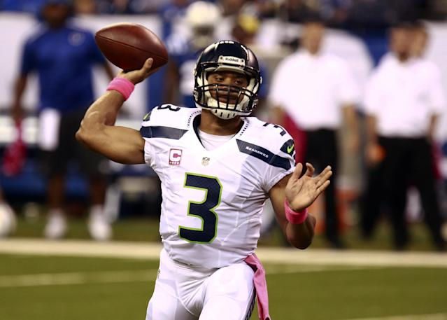 Seattle Seahawks quarterback Russell Wilson throws against the Indianapolis Colts during the first half of an NFL football game in Indianapolis, Sunday, Oct. 6, 2013. (AP Photo/Brent R. Smith)