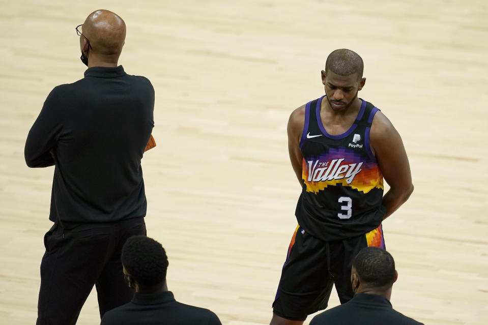 Phoenix Suns guard Chris Paul (3) stands next to head coach Monty Williams during the second half of Game 5 of basketball's NBA Finals against the Milwaukee Bucks, Saturday, July 17, 2021, in Phoenix. (AP Photo/Ross D. Franklin)