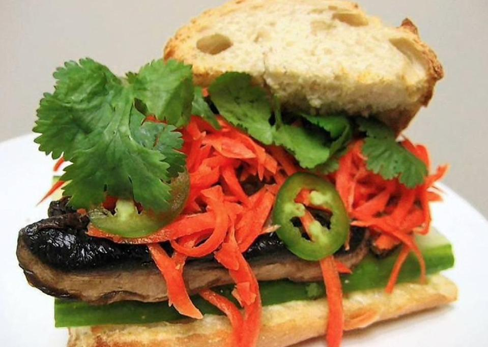 """<p><a href=""""https://www.thedailymeal.com/recipes/banh-mi-vietnamese-sandwich?referrer=yahoo&category=beauty_food&include_utm=1&utm_medium=referral&utm_source=yahoo&utm_campaign=feed"""" rel=""""nofollow noopener"""" target=""""_blank"""" data-ylk=""""slk:Banh mi sandwiches"""" class=""""link rapid-noclick-resp"""">Banh mi sandwiches</a> are a <a href=""""https://www.thedailymeal.com/travel/iconic-dishes-around-the-world-recipes?referrer=yahoo&category=beauty_food&include_utm=1&utm_medium=referral&utm_source=yahoo&utm_campaign=feed"""" rel=""""nofollow noopener"""" target=""""_blank"""" data-ylk=""""slk:popular street food in Vietnam"""" class=""""link rapid-noclick-resp"""">popular street food in Vietnam</a> and are typically served with an assortment of meats. This plant-based take on the sandwich is stacked with marinated mushrooms, cucumber, cilantro and jalapeno peppers, making it a <a href=""""https://www.thedailymeal.com/cook/50-vegetarian-recipes-meatless-mondays-or-any-other-time-slideshow?referrer=yahoo&category=beauty_food&include_utm=1&utm_medium=referral&utm_source=yahoo&utm_campaign=feed"""" rel=""""nofollow noopener"""" target=""""_blank"""" data-ylk=""""slk:great dinner option for vegetarians"""" class=""""link rapid-noclick-resp"""">great dinner option for vegetarians</a>.</p> <p><a href=""""https://www.thedailymeal.com/recipes/banh-mi-chay-sandwich-recipe?referrer=yahoo&category=beauty_food&include_utm=1&utm_medium=referral&utm_source=yahoo&utm_campaign=feed"""" rel=""""nofollow noopener"""" target=""""_blank"""" data-ylk=""""slk:For the Banh Mi Chay Sandwich recipe, click here."""" class=""""link rapid-noclick-resp"""">For the Banh Mi Chay Sandwich recipe, click here.</a></p>"""