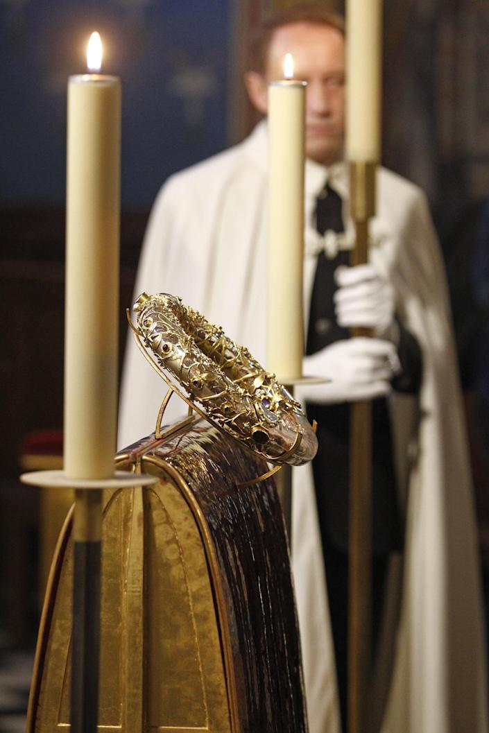 A knight of the Order of the Holy Sepulchre stands near a crown of thorns which was believed to have been worn by Jesus Christ and which was bought by King Louis IX in 1239 is presented at Notre Dame Cathedral in Paris, Friday March 21, 2014. To mark the 800th anniversary of Louis IX's christening, the crown of thorns will be displayed outside Notre Dame, at the Collegiate Church of Poissy, where King Louis IX was christened. (AP Photo/Remy de la Mauviniere)