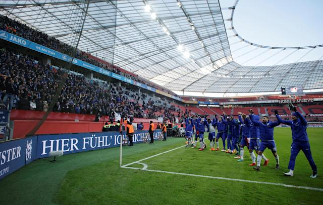 Soccer Football - Bundesliga - Bayer Leverkusen vs Schalke 04 - BayArena, Leverkusen, Germany - February 25, 2018 Schalke players celebrate after the match REUTERS/Thilo Schmuelgen DFL RULES TO LIMIT THE ONLINE USAGE DURING MATCH TIME TO 15 PICTURES PER GAME. IMAGE SEQUENCES TO SIMULATE VIDEO IS NOT ALLOWED AT ANY TIME. FOR FURTHER QUERIES PLEASE CONTACT DFL DIRECTLY AT + 49 69 650050