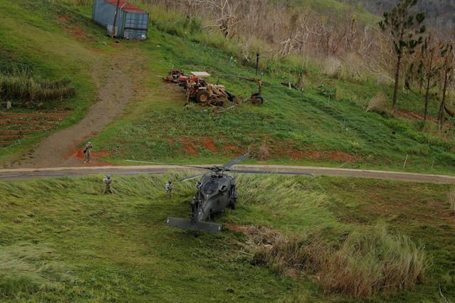 A helicopter from U.S. Army's First Armored Division's Combat Aviation Brigade lands in a field to deliver food and water during recovery efforts following Hurricane Maria near Ciales, P.R., on Oct. 7. (Photo: Lucas Jackson/Reuters)
