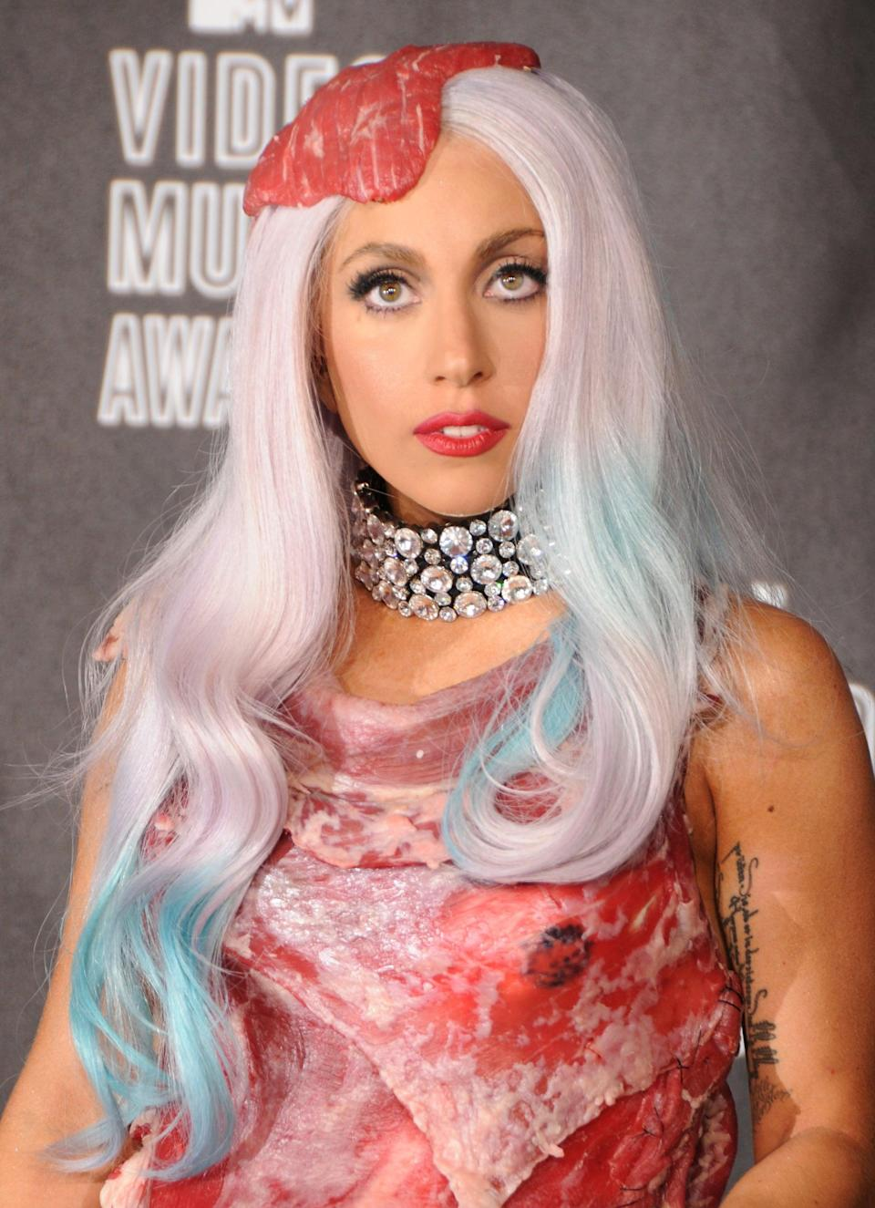 """<p>Who can forget the memorable meat ensemble <a class=""""link rapid-noclick-resp"""" href=""""https://www.popsugar.com/Lady-Gaga"""" rel=""""nofollow noopener"""" target=""""_blank"""" data-ylk=""""slk:Lady Gaga"""">Lady Gaga</a> wore to the 2010 MTV VMAs? This look will work best if you spray your hair in a silvery-white color and wear it in loose curls. To make it all the more authentic, add a splash of turquoise spots throughout. </p>"""
