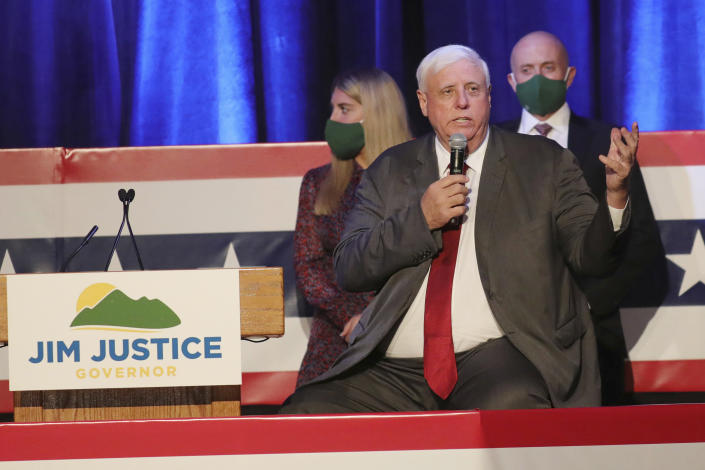 FILE - In this Nov. 3, 2020, file photo, West Virginia Gov. Jim Justice celebrates his reelection at The Greenbrier Resort in White Sulphur Springs, W.Va. While the United States doubled its population over the past seven decades, West Virginia headed in the other direction. With West Virginia poised to lose another congressional seat due to its long, steady population decline, Republican lawmakers are convinced a massive tax cut is the key to reversing the trend.(AP Photo/Chris Jackson, File)