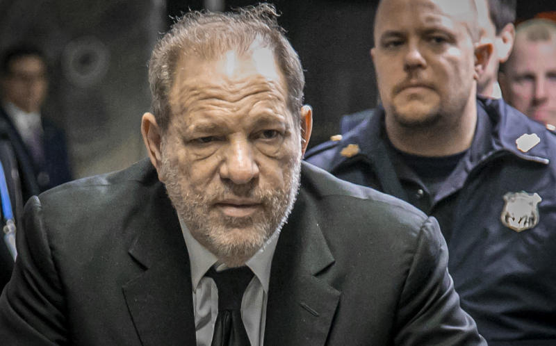 Harvey Weinstein leaves a Manhattan courthouse after a second day of jury selection for his trial on rape and sexual assault charges. (AP Photo/Bebeto Matthews)