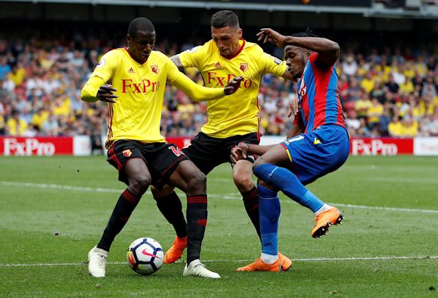 """Soccer Football - Premier League - Watford v Crystal Palace - Vicarage Road, Watford, Britain - April 21, 2018 Crystal Palace's Wilfried Zaha in action with Watford's Jose Holebas and Abdoulaye Doucoure Action Images via Reuters/Paul Childs EDITORIAL USE ONLY. No use with unauthorized audio, video, data, fixture lists, club/league logos or """"live"""" services. Online in-match use limited to 75 images, no video emulation. No use in betting, games or single club/league/player publications. Please contact your account representative for further details."""