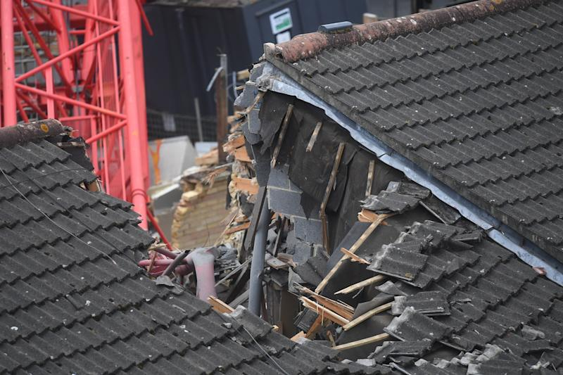 View of the damage caused in Bow, east London, where a 20-metre crane has collapsed on to a house leaving people trapped inside.