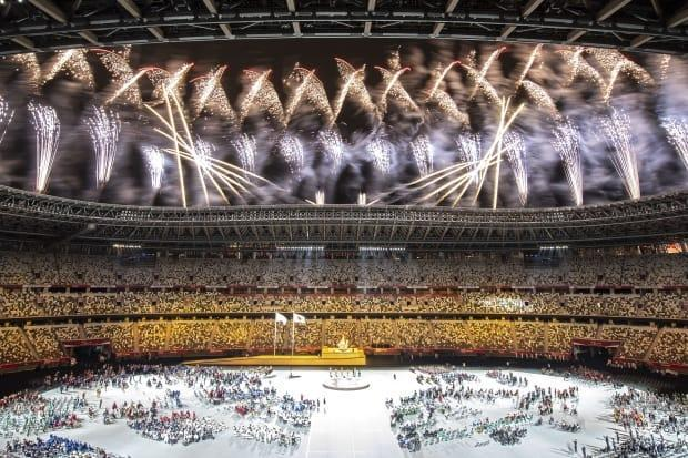 Fireworks are seen during the opening ceremony of the Tokyo 2020 Paralympic Games following the lighting of the cauldron at the National Stadium on Tuesday. (Charly Triballeau/AFP via Getty Images - image credit)