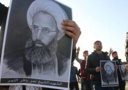 Shi'ite Muslims hold pictures of Shi'ite Muslim cleric Nimr al-Nimr during a protest against his execution in Saudi Arabia, in Basra