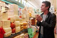 <p>Bourdain waits for his first sample of Canadian cheese in Mendels Creamery in Toronto on April 2, 2002.</p>