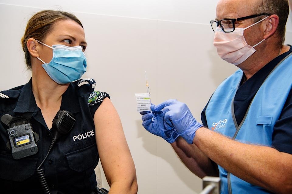 South Australian policewoman Amanda Kuchel receives the Pfizer Vaccine at the Royal Adelaide Hospital in Adelaide on Monday. Source: AAP