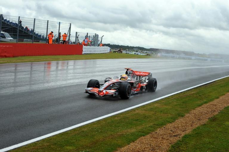 Rain king: Lewis Hamilton cruised to victory through the Silverstone puddles in 2008