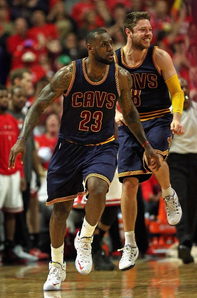 LeBron James (L) and Matthew Dellavedova of the Cleveland Cavaliers celebrate a win over the Chicago Bulls in Game Four of the Eastern Conference Semifinals of the 2015 NBA Playoffs on May 10, 2015 in Chicago