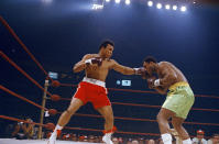 <p>Muhammad Ali, red trunks, and Joe Frazier, green trunks, are shown during round 5 or 6 of their bout in New York's Madison Square Garden, March 8, 1971. (John Lindsay/AP Photo)</p>
