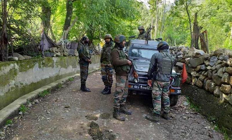 Security personnel at an encounter site in Kashmir. Hilal Shah