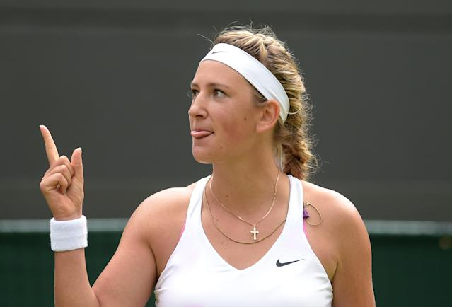 Belarus's Victoria Azarenka celebrates winning her women's singles first round match against Croatia's Mirjana Lucic-Baroni on day one of the 2014 Wimbledon Championships at The All England Tennis Club on June 23, 2014 (AFP Photo/Carl Court)