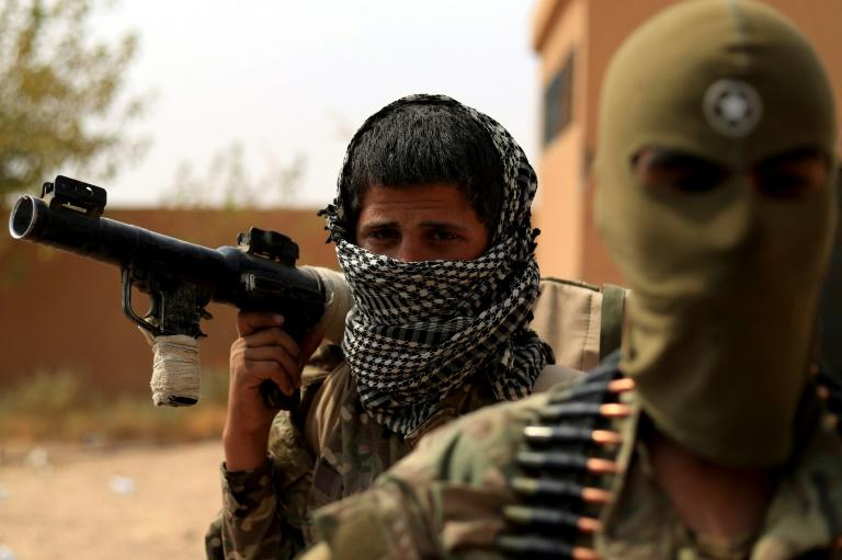 """Kurdish-led fighters have overrun the last village held by the Islamic State group in Syria, confining its once vast cross-border """"caliphate"""" to two small hamlets on the north bank of the Euphrates river"""