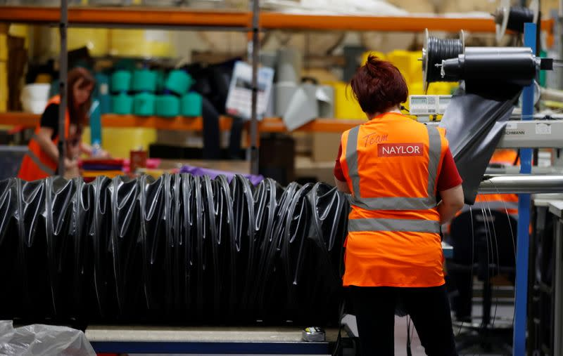 A worker constructs a length of ducting tube inside the Naylor Industries Wombwell site in Wombwell