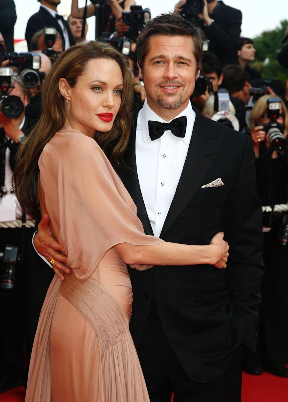 "<p>In the early 2000s, people idolized the relationship between Jennifer Aniston and Brad Pitt. So Brad ~devastated~ them when he left the <em>Friends </em>star for Angelina Jolie in 2005. The tabloids endlessly reported on the details of the split and Brad's new relationship. Even now, after Brangelina divorced, <a href=""https://www.etonline.com/jennifer-aniston-and-brad-pitt-have-laughed-about-the-publics-freakout-over-their-reunion-140032"" rel=""nofollow noopener"" target=""_blank"" data-ylk=""slk:fans are holding out hope"" class=""link rapid-noclick-resp"">fans are holding out hope</a> for a Jen and Brad reunion.</p>"