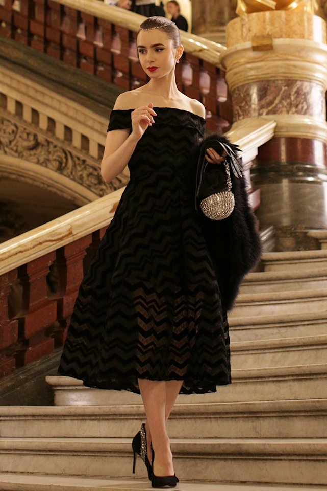 <p>Of course, we'll never get over this impeccable off-the-shoulder dress that oozes classy Audrey Hepburn vibes. The headpiece! That bag! I #cant.</p>