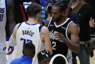 Dallas Mavericks guard Luka Doncic (77) talks with Los Angeles Clippers forward Kawhi Leonard (2) after Game 7 of an NBA basketball first-round playoff series Sunday, June 6, 2021, in Los Angeles, Calif. The Clippers won the game 126-111, and the series 4-3. (AP Photo/Ashley Landis)