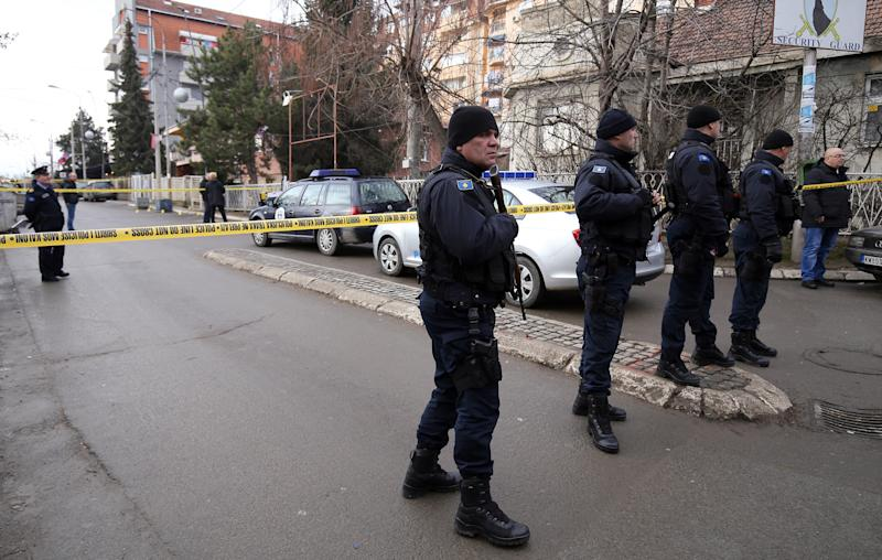"Police officers guard a scene where unknown assailants opened fire on Kosovo Serb politician Oliver Ivanovic in front of his office in the northern, Serb-dominated part of Mitrovica, Kosovo, Tuesday, Jan. 16, 2018. The Kosovo government has strongly denounced the slaying of a leading Serb politician in northern Mitrovica and says it considers it to be a challenge to ""the rule of law"". (AP Photo/Bojan Slavkovic)"