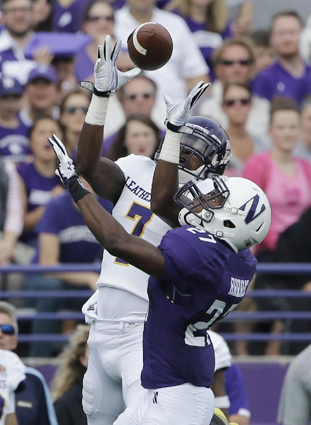 Western Illinois wide receiver Lance Lenoir Jr. (7) catches the ball against Northwestern cornerback Matthew Harris (27) during the first half of an NCAA college football game in Evanston, Ill., Saturday, Sept. 20, 2014. (AP Photo/Nam Y. Huh)