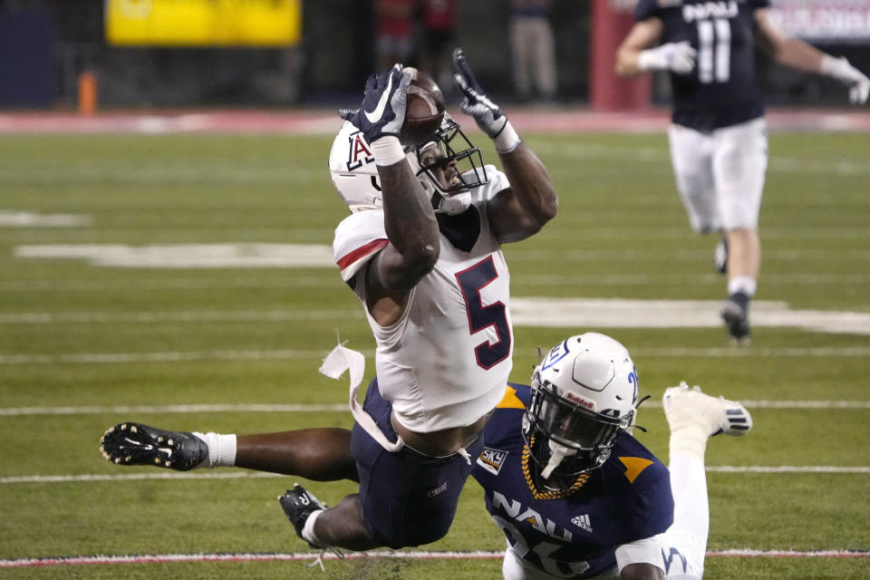 Arizona wide receiver BJ Casteel (5) can not make the catch in front of Northern Arizona defensive back Colby Humphrey during the first half of an NCAA college football game, Saturday, Sept. 18, 2021, in Tucson, Ariz. (AP Photo/Rick Scuteri)