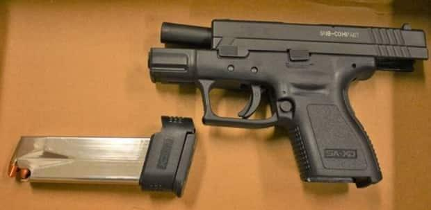 Police say this fully loaded Springfield Armory XD-9 9mm semi-automatic handgun with an over capacity magazine was located during a search connected to a kidnapping case in North York. (Toronto Police Service - image credit)