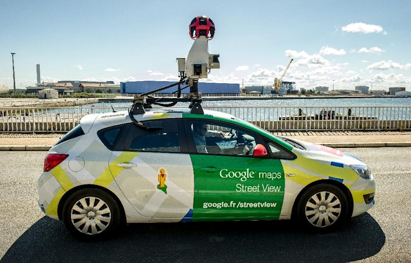 A Google Street View vehicle collects imagery for Google Maps while driving down a street in Calais, northern France, on July 29, 2015 (AFP Photo/Philippe Huguen)