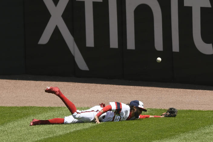 Chicago White Sox center fielder Billy Hamilton (0) misses a triple hit by Baltimore Orioles' Cedric Mullins during the third inning of a baseball game Sunday, May 30, 2021, in Chicago. (AP Photo/Paul Beaty)