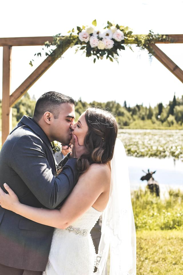 The newlyweds were able to get the unexpected moose-crashing moment on camera. (Photo: Bria Celest/celestimages.com)