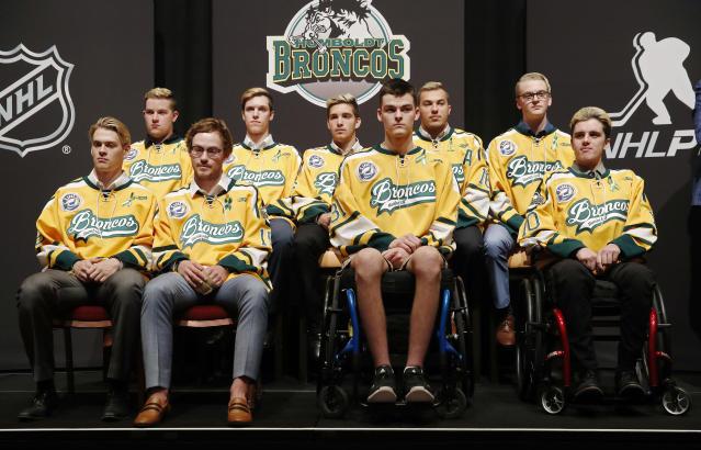 Survivors of the Humboldt Broncos bus crash in April gathered at the NHL awards on Wednesday night in Las Vegas, and helped receive the inaugural Willie O'Ree Community Hero Award on behalf of their fallen coach. (AP Photo/John Locher)