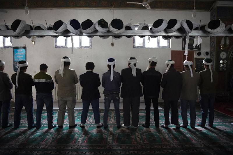 Uighur's pray in Xinjiang in 2015. UN chief Antonio Guterres was under pressure from rights groups to publicly confront Beijing over the mass detention of the Muslim minority
