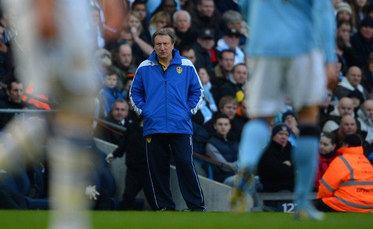 Leeds United's manager Neil Warnock (C) looks on in Manchester on February 17, 2013