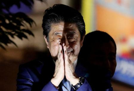FILE PHOTO: Japan's Prime Minister Shinzo Abe gestures at an election campaign rally in Tokyo, Japan October 20, 2017. REUTERS/Kim Kyung-Hoon/File Photo