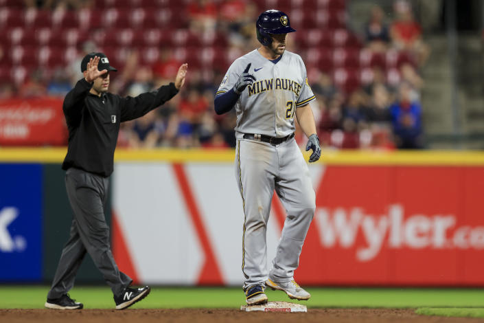 Milwaukee Brewers' Travis Shaw stands on second base after hitting a two-run double during the ninth inning of tgeh team's baseball game against the Cincinnati Reds in Cincinnati, Tuesday, June 8, 2021. The Brewers won 5-1. (AP Photo/Aaron Doster)