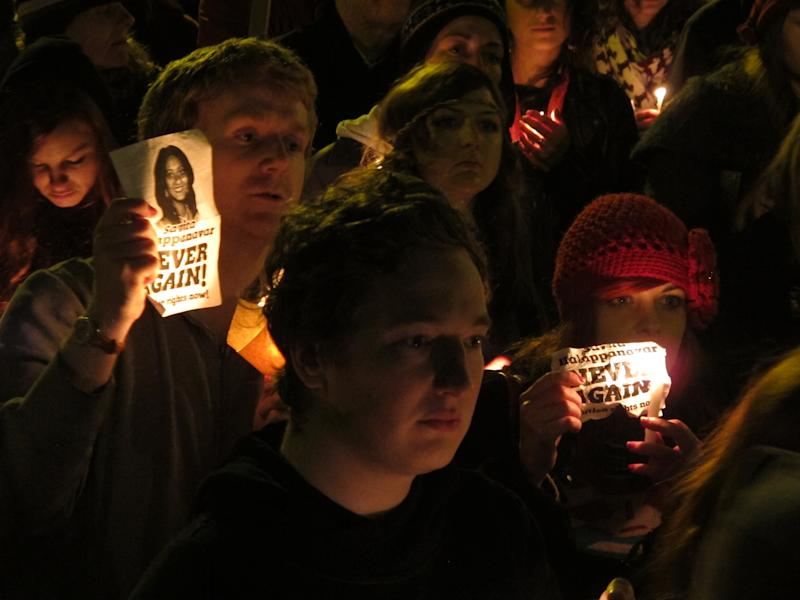 FILE - This Saturday, Nov. 17, 2012 file photo shows abortion rights protesters holding candles and pictures in a vigil for Savita Halappanavar outside Ireland's government headquarters in Dublin. Ireland's government has published a long-awaited bill, Wednesday May 1, 2013, explaining the law on when life-saving abortions can be performed in a country that officially bans the practice. (AP Photo/Shawn Pogatchnik, File)