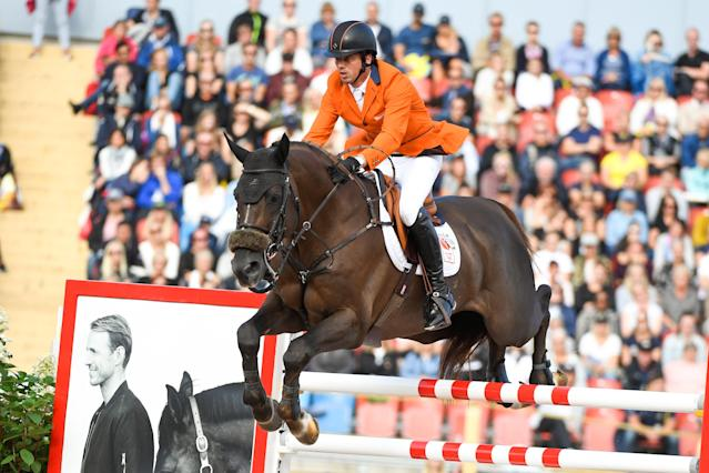 Equestrian - FEI European Championships 2017 - Jumping Individual Final - Ullevi Stadium, Gothenburg, Sweden - August 27, 2017 - Harrie Smolders of the Netherlands on his horse Don VHP Z jumps. TT News Agency/Pontus Lundahl via REUTERS ATTENTION EDITORS - THIS IMAGE WAS PROVIDED BY A THIRD PARTY. SWEDEN OUT. NO COMMERCIAL OR EDITORIAL SALES IN SWEDEN