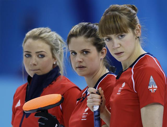 Great Britain's Anna Sloan, left to right, Vicki Adams and Claire Hamilton watch a shot during their round robin curling match against Japan at the 2014 Winter Olympics, Friday, Feb. 14, 2014, in Sochi, Russia. (AP Photo/Morry Gash)