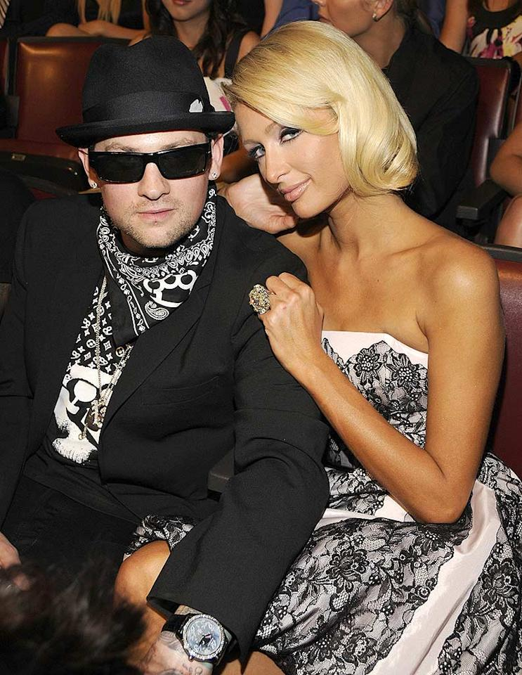 """Benji Madden continued to make a fool of himself in yet another hideous outfit, while his Oompa-Loompa-like girlfriend Paris Hilton likely stained her seat with bronzer. Kevin Mazur/<a href=""""http://www.wireimage.com"""" target=""""new"""">WireImage.com</a> - June 1, 2008"""