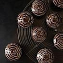 """<p>These web-topped, chocolate-frosted red velvet wonders are filled with a spooky surprise — a sweet and creamy filling loaded with chewy tapioca pearls.</p><p>Get the recipe from <a href=""""https://www.delish.com/cooking/recipe-ideas/recipes/a17073/red-velvet-spider-web-cupcakes-recipe-fw1011/"""" rel=""""nofollow noopener"""" target=""""_blank"""" data-ylk=""""slk:Delish"""" class=""""link rapid-noclick-resp"""">Delish</a>.</p>"""