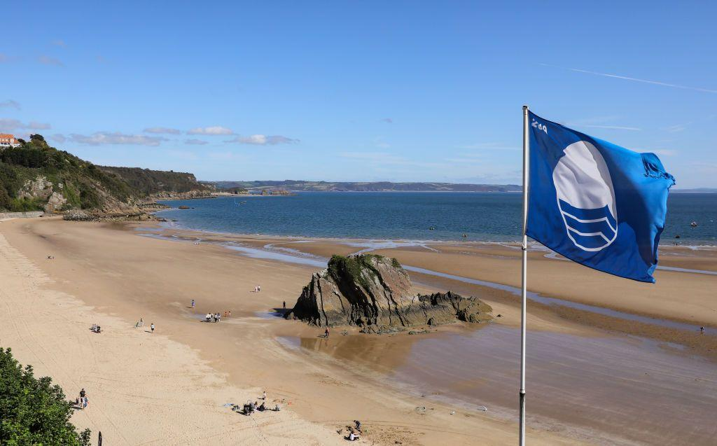 """<p>For the best beaches in South Wales, look no further than picturesque Tenby and the harbour town's North Beach. The unrivalled coastal spot is one of the most photographed locations in Wales thanks to its superb sand and Goscar Rock sticking out of the middle of it. A sun trap even on windy days, it has a Blue Flag for its water quality and is overlooked by the town of Tenby.</p><p><strong>Where to stay: </strong>For a seriously impressive holiday cottage that sits right on North Beach, this modern apartment sleeps six and offers incredible views from various spaces. <a class=""""body-btn-link"""" href=""""https://go.redirectingat.com?id=127X1599956&url=https%3A%2F%2Fwww.holidaycottages.co.uk%2Fcottage%2F60757-goscar-view&sref=https%3A%2F%2Fwww.redonline.co.uk%2Ftravel%2Ftravel-guides%2Fg33008606%2Fbest-beaches-wales%2F"""" target=""""_blank"""">SEE INSIDE</a></p>"""