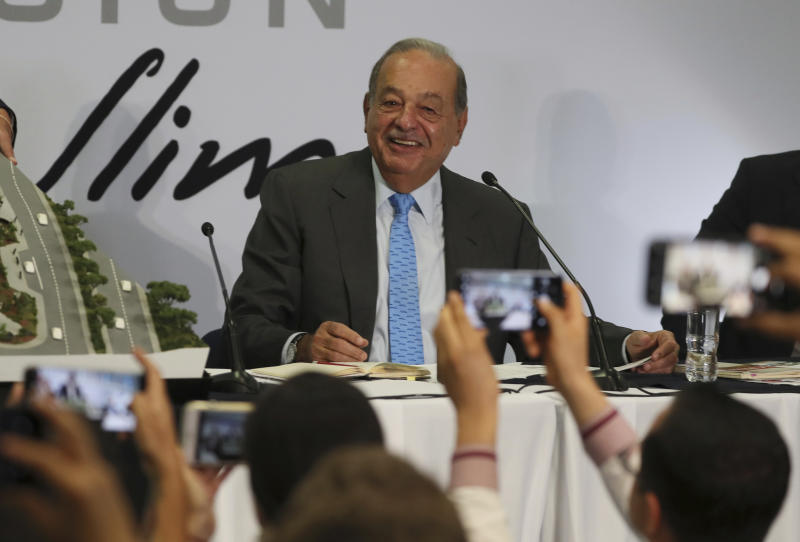 Mexican billionaire Carlos Slim takes questions from the journalists during a news conference at his office in Mexico City, Wednesday, Oct. 16, 2019. Slim says he supports President Andrés Manuel López Obrador's objectives. (AP Photo/Fernando Llano)