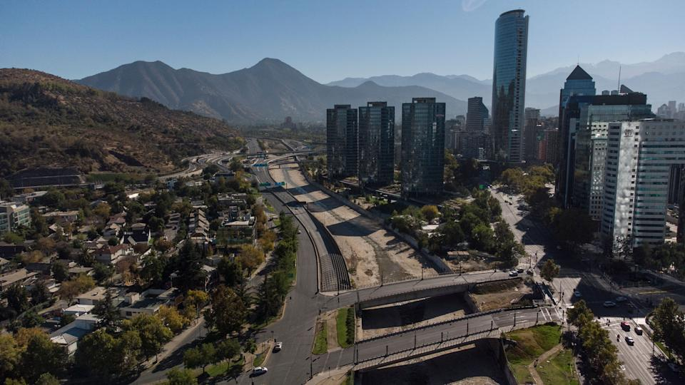 Aerial view of Santiago in lockdown, on March 27, 2021, amid the COVID-19 pandemic. - Almost 16 million people, about 80% of the population, began a new quarantine in Chile due to a sharp increase in new cases of Covid-19, despite an impressive vaccination campaign. Chilean authorities have been implementing, among other measures, a selective quarantine in areas with a high incidence of infection and have placed an emphasis on controlling the pandemic by mass screening. (Photo by MARTIN BERNETTI / AFP) (Photo by MARTIN BERNETTI/AFP via Getty Images)
