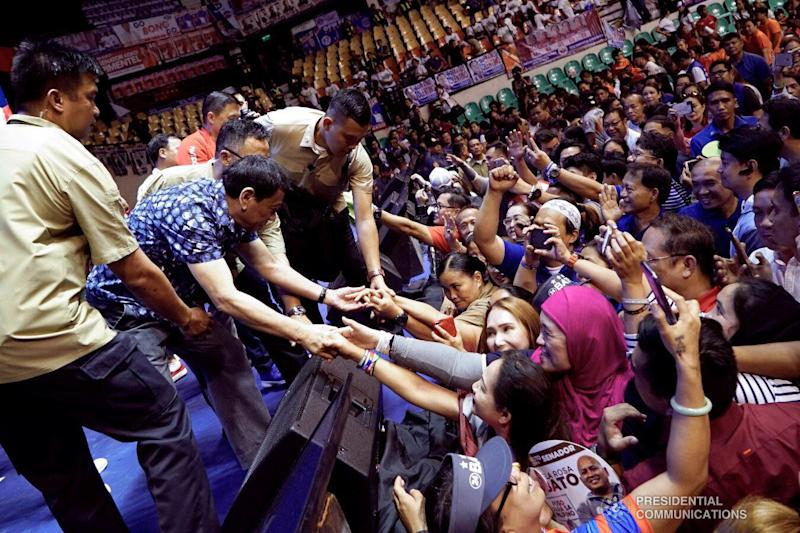 Philippine President Rodrigo Duterte interacts with his supporters at the PhilSports Multi-Purpose Arena in Pasig City on May 11, 2019. (Photo: KING RODRIGUEZ/PRESIDENTIAL PHOTO)